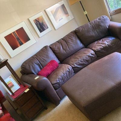 Photography and a fine leather couch and ottoman