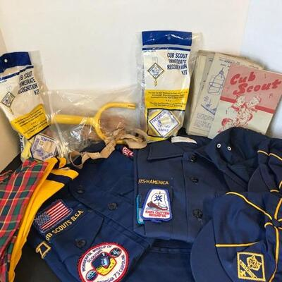 Boy Scout and 2 Cub Scout shirts, one pair of pants(patch work),  three hats, three kerchiefs, a vintage sling shot toy, 2 recognition...
