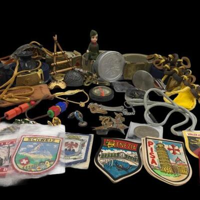 This lot contains a variety of Boy Scout Memorabilia. It contains pins, compass, badges, a statue, belts, and a utility knife....