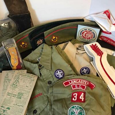 """Two vintage Boy Scout shirts along with a pair of pants (Youth Large), three hats, patches, socks, suspenders, and knife carrier(11""""). It..."""