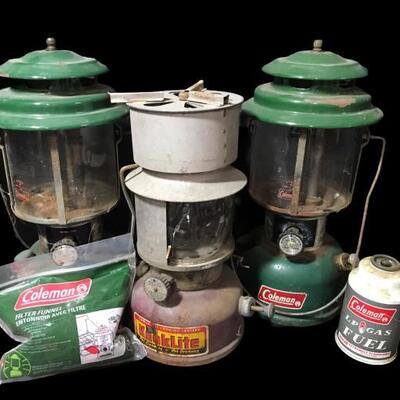 This lot contains 2 Coleman and a Kooklite Kerosene Lantern, one LP Gas Fuel, and Filter Funnel....