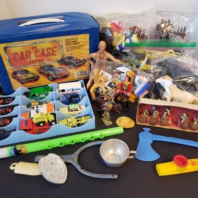 Includes Matchbox cars with case, plastic musical instruments, Rag time band and other vintage toys....