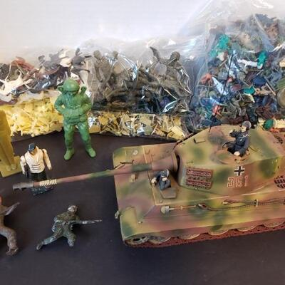 Includes plastic and metal Army men, horses and tank (measures 11