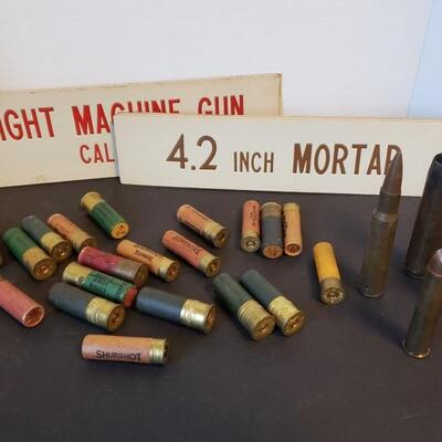 Bullet casings from WWII and artillery signs that measure 13 1/2