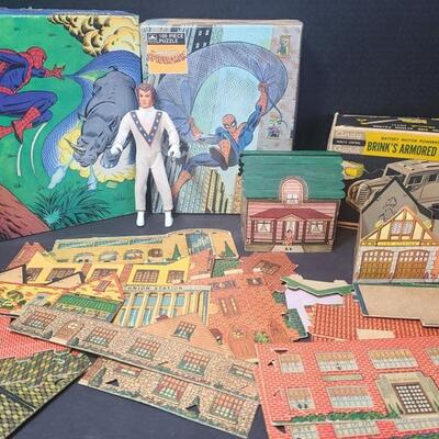 Two vintage Spiderman puzzles, cannot verify if all pieces are there. Cardboard town comes with school, fire station, Union Station,...