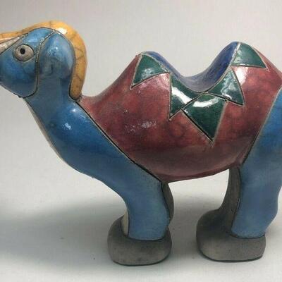 https://www.ebay.com/itm/114889037101ME7006 South African Raku Pottery Camel Figurine (blue and yellow head)