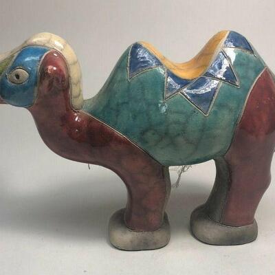 https://www.ebay.com/itm/114889037640ME7007 South African Raku Pottery Camel Figurine (white, red, and blue head
