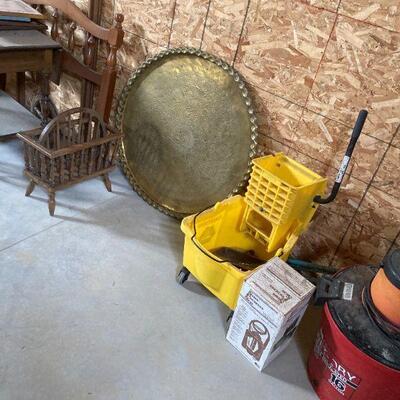 brass top table. mop bucket