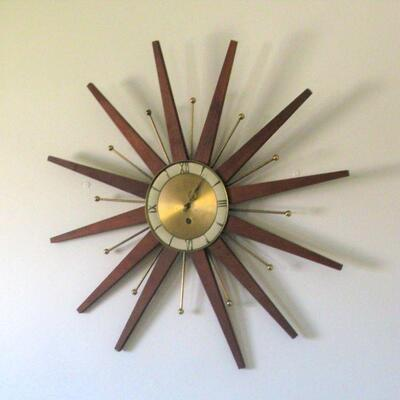 mcm starburst wall clock, mad in Germany                                          buy it now $ 225.00    OR BEST OFFER