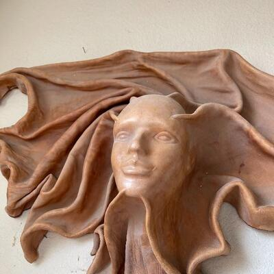 Leather carved ladies face