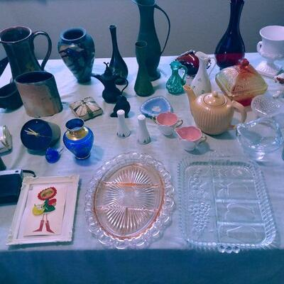 Large  Assortment of Glassware on Each Driveway