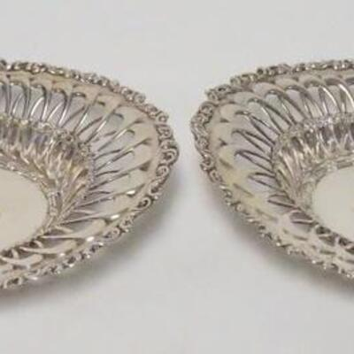1051PAIR OF ORNATE STERLING SILVER OVAL BOWLS, MONOGRAMMED, OPEN WORK EDGES, MARKED WITH A WAND RAMPANT LION, 8 1/4 N X 6 1/2 IN, 8.295...