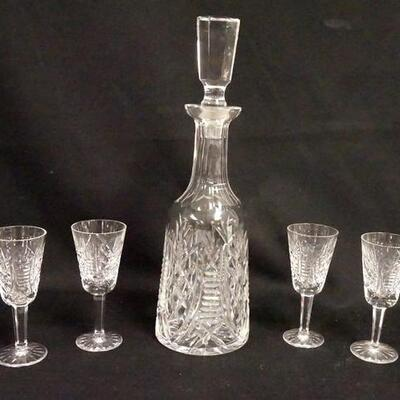 1014WATERFORD CRYSTAL 5 PIECE WHISKEY SET. THERE IS A SMALL BUMP ON THE SHANK OF THE STOPPER, DECANTER IS 13 3/4 IN HIGH, STEMS ARE 5...