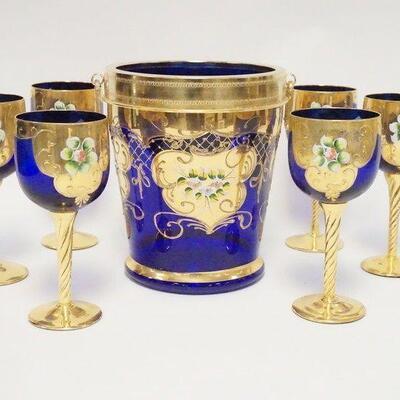 10367 PIECE ITALIAN BLOWN GLASS GOBLETS & ICE BUCKET, COBALT BLUE W/GOLD TRIM & APPLIED PORCELAIN, ICE BUCKET HAS A METAL RIM & HANDLES,...