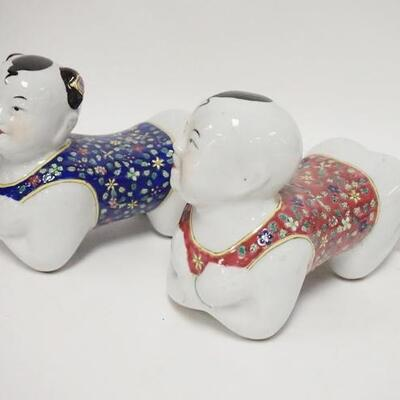 1084PAIR OF ASIAN PORCELAIN FIGURAL PILLOWS, 8 3/4 IN LONG X 7 IN HIGH