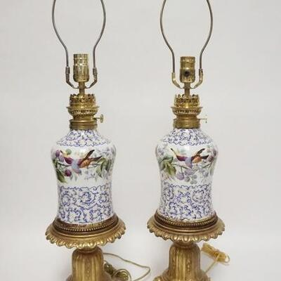 1077PAIR OF HAND PAINTED PORCELAIN LAMPS, HAVE BEEN ELECTRIFIED, WICK TURNERS MARKED FRANCE, CORDS HAVE BEEN CUT, 29 3/4 IN HIGH
