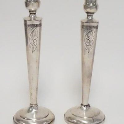 1019PAIR OF WEIGHTED STERLING SILVER CANDLESTICKS, BOBACHES ALSO MARKED STERLING, SOME DENTING & TWISTING, 9 3/4 IN HIGH