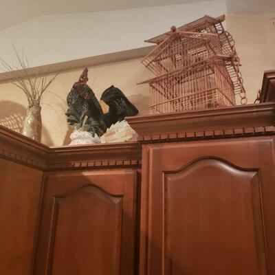 wooden bird cage and rooster
