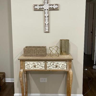 Entryway Table in Natural Wood and Off White Scrolls  Item #1030 Price $100  Wood Carved Cross  Item #1031 Price $20  Small Wicker Basket...