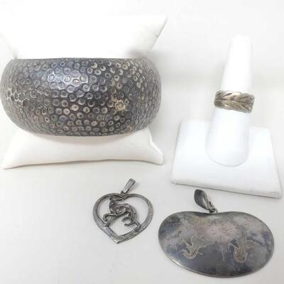 1526  Vintage Sterling Silver Bangle, Leaf Ring, Dog In Heart Pendant And Siam Pendant 82.7g Weighs 82.7g Ring Size 7.5 Bangle Measures...