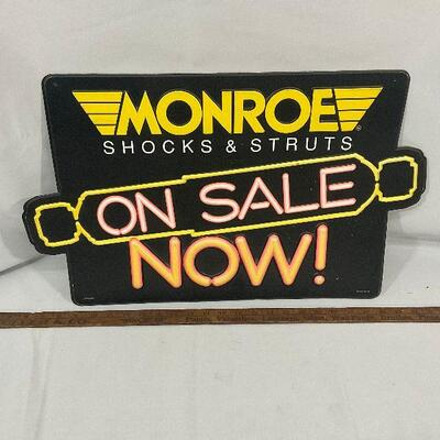 monroe shocks plastic store sign