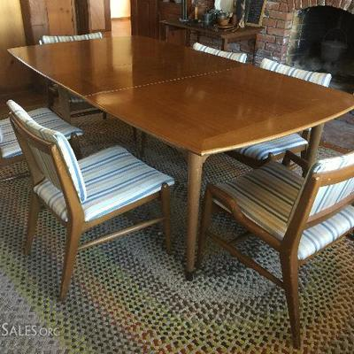 Mid Century dining table and 6 chairs (has two leaves); antique braided rug